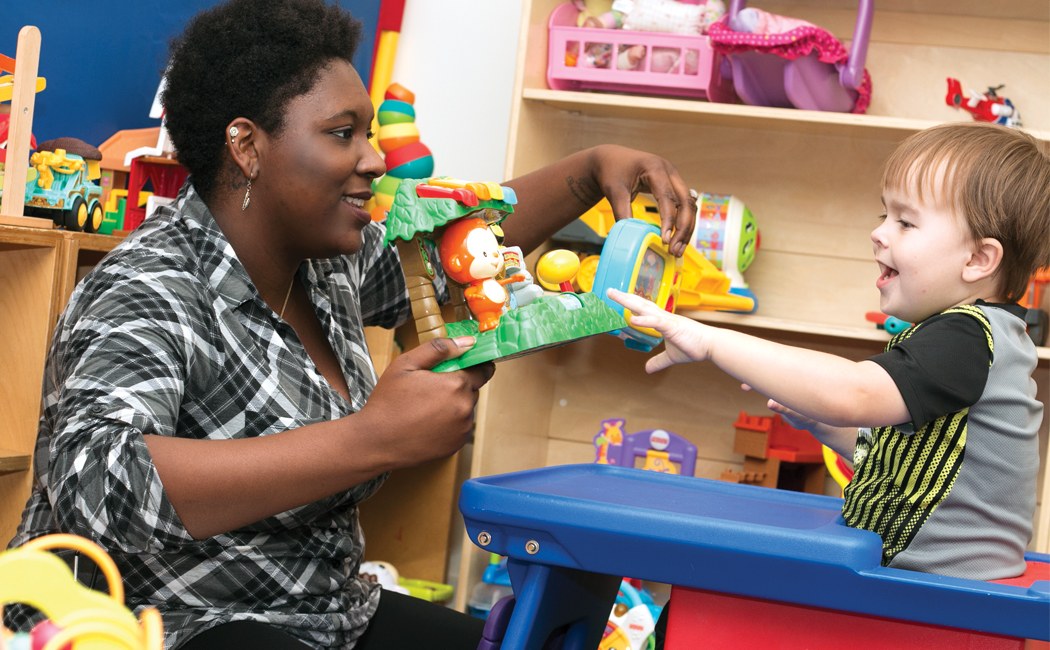 Micheale Marcus, left, works with one of her clients at UNMC's Autism Care for Toddlers Clinic. The clinic provides services to children with autism, and their families.