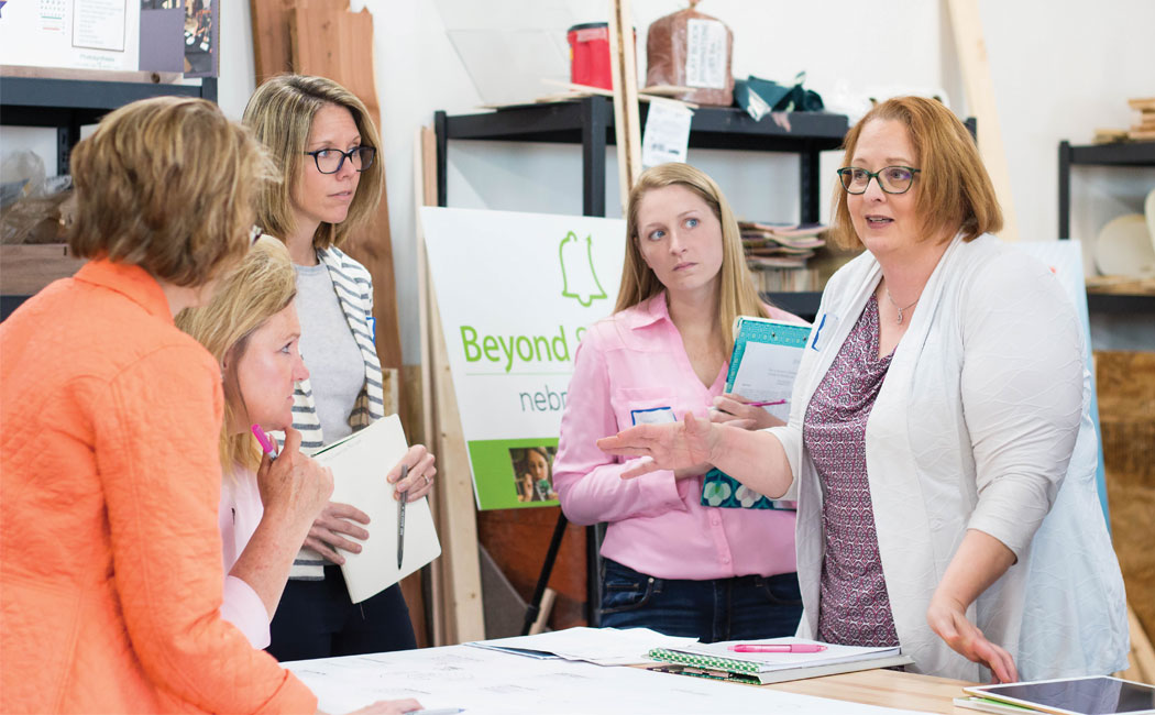 CYFS evaluators (from right) Michelle Howell Smith, Susan Pense and Leslie Hawley provide feedback to teachers and school personnel participating in the ELO Design Challenge. The project is supporting five rural Nebraska school districts as they develop after-school and summer programs.