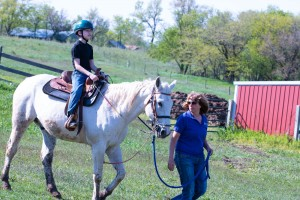 Jacob, 12, rides Leo as Horses for Healing Instructor Justy Hagan leads.